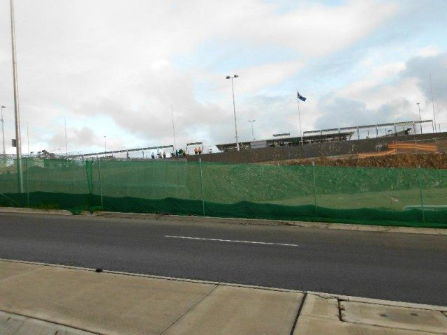 green shade fence construction site
